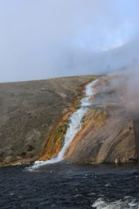 A stream of steaming water flanked on both sides by vibrant orange.