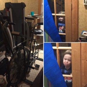 An old fanwheel exercise bike and my nephew peeking through the window at me.