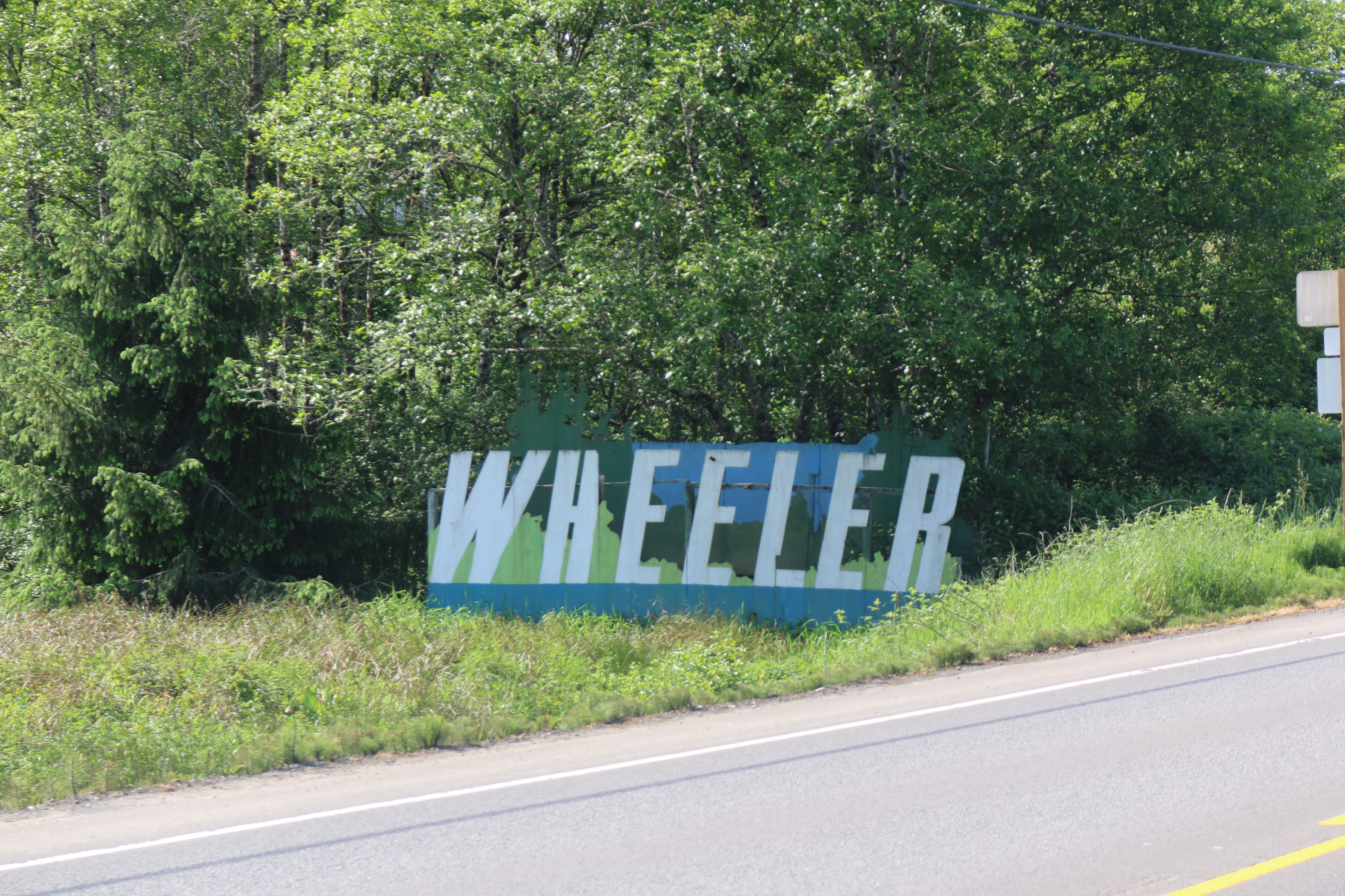 "A town sign reading ""Wheeler"""